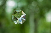 Crystal prism on defocused green background