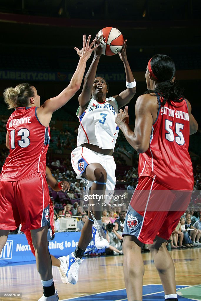 Crystal Robinson of the New York Liberty drives against Kelly Mazzante of the Charlotte Sting at Madison Square Garden on August 14 2005 in New York...