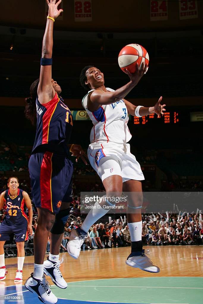 Crystal Robinson of the New York Liberty drives against Taj McWilliamsFranklin of the Connecticut Sun at Madison Square Garden on July 7 2005 in New...