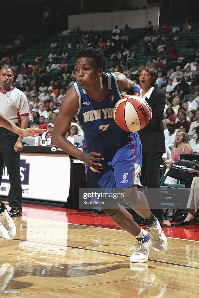 Crystal Robinson of the New York Liberty drives against the Charlotte Sting during the WNBA game on June 25 2005 at the Charlotte Coliseum in...