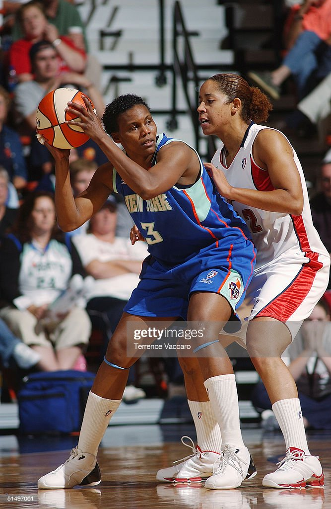 Crystal Robinson of the New York Liberty looks to make the pass against Nykesha Sales of the Connecticut Sun at Mohegan Sun during the 2004 WNBA...