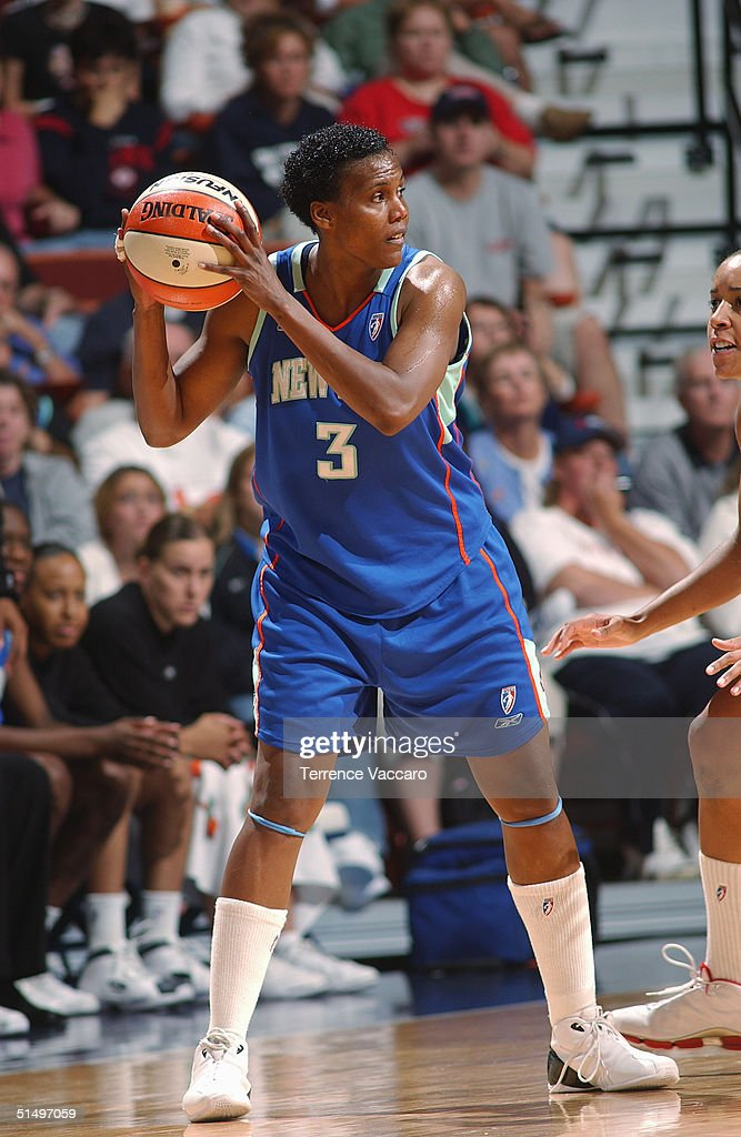 Crystal Robinson of the New York Liberty looks to make the pass against the Connecticut Sun at Mohegan Sun during the 2004 WNBA Playoffs on September...