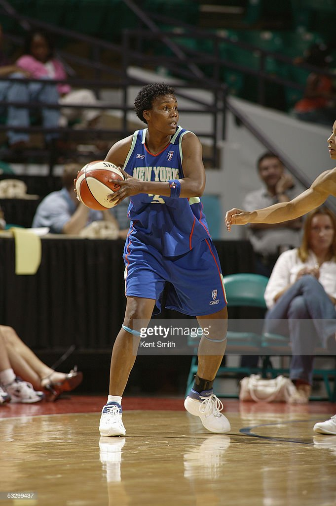 Crystal Robinson of the New York Liberty looks to pass against the Charlotte Sting during the WNBA game on June 25 2005 at the Charlotte Coliseum in...