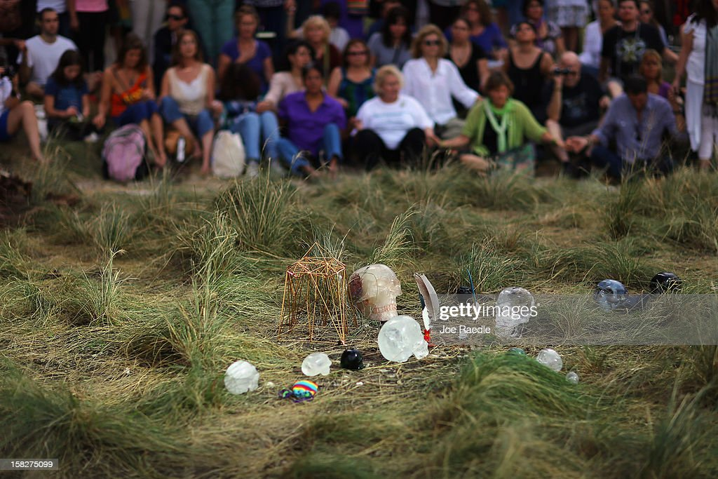 Crystal skulls are seen on the ground during a sacred 12.12.12 ceremony at Miami Circle which is a Tequesta indian site used centuries ago on December 12, 2012 in Miami, United States. The ceremony was held on the calender date of 12-12-12 which is the last major numerical date using the Gregorian or Christian calendar for almost another century.