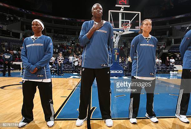 Crystal Smith Nakia Sanford and Laurie Koehn of the Washington Mystics line up on the court prior to the game against the Detroit Shock at the...