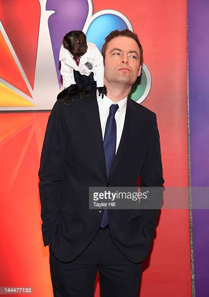 Crystal the Capuchin monkey and actor Justin Kirk attend NBC's Upfront Presentation at 51st Street on May 14 2012 in New York City