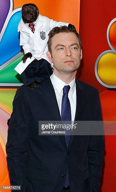 Crystal the Monkey and actor Justin Kirk attend NBC's Upfront Presentation at Radio City Music Hall on May 14 2012 in New York City