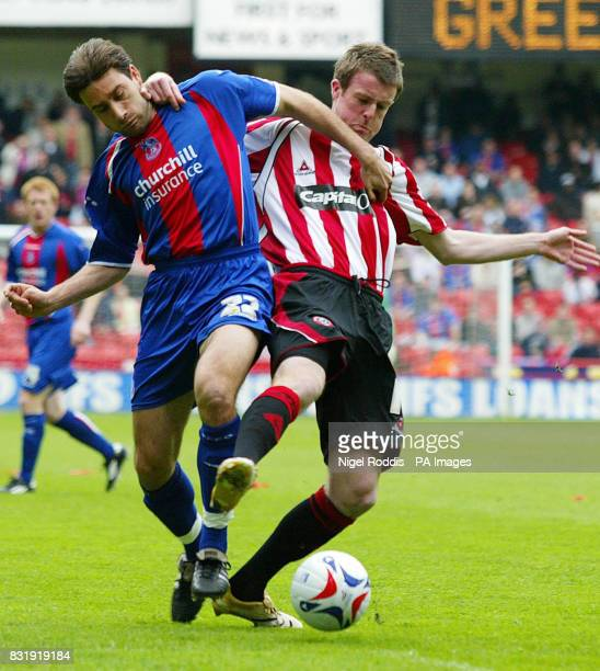 Crytal Palace's Marco Reich challenges Sheffield United's Michael Tonge for the ball during the CocaCola Championship match at Bramall Lane Sheffield