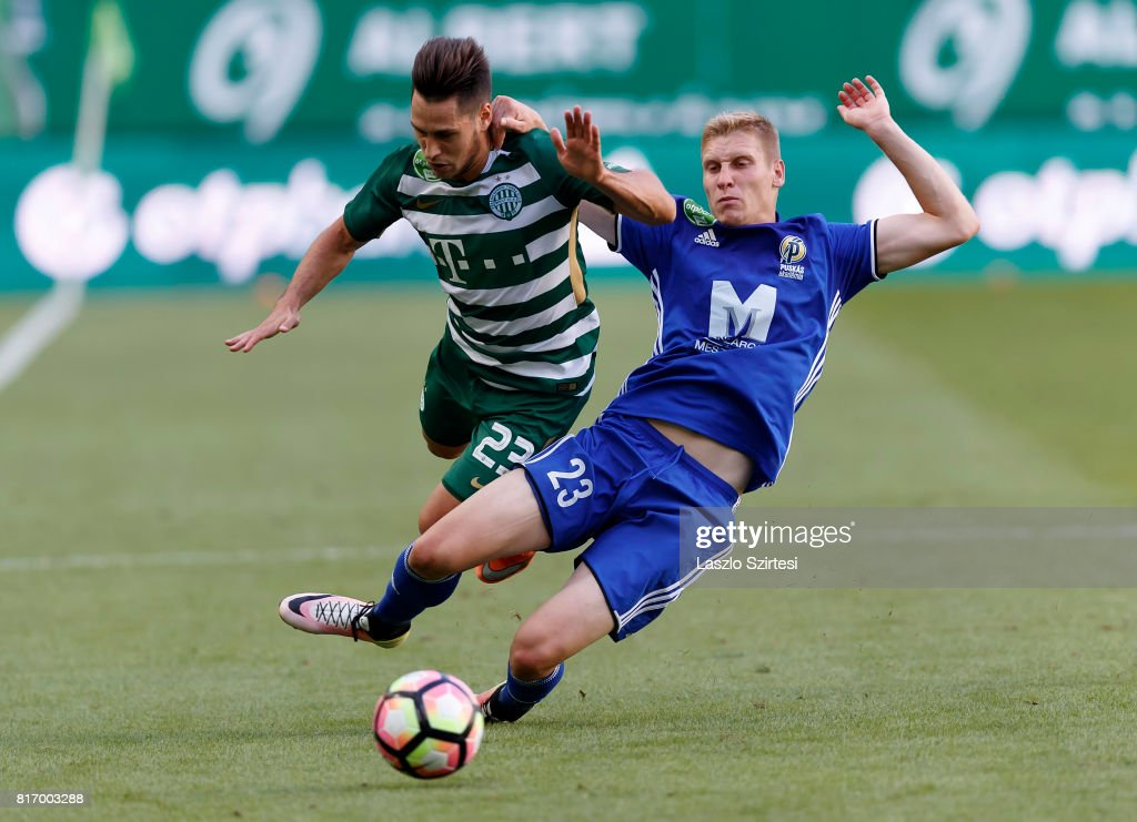 Csaba Spandler (R) of Puskas Akademia FC slide tackles Lukacs Bole (L) of Ferencvarosi TC during the Hungarian OTP Bank Liga match between Ferencvarosi TC and Puskas Akademia FC at Groupama Arena on July 16, 2017 in Budapest, Hungary.