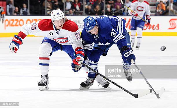 Csey Bailey of the Toronto Maple Leafs battles for the puck with Jeff Petry of the Montreal Canadiens during NHL game action April 11 2015 at the Air...