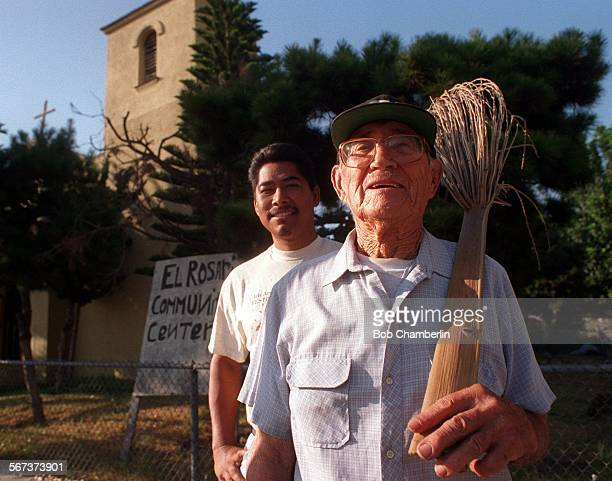 CTChurch08–02BC/DLuis Plascencia who attended Holy Rosary Mission Church for 25 years and Max Terronez ##background%% in front of the church which...