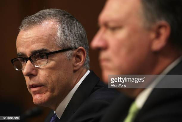 cting FBI Director Andrew McCabe and Central Intelligence Agency Director Mike Pompeo testify before the Senate Intelligence Committee with the other...