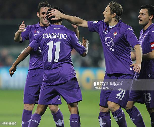 Cuadrado with his teammate Gonzalo Rodriguez and Massimo Ambrosini of ACF Fiorentina celebrates after scoring the opening goal during the Serie A...