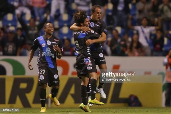 Cuahtemoc Blanco of Puebla celebrates after scoring the second goal of his team with Gerardo Espinoza during a match between Puebla and Santos Laguna...