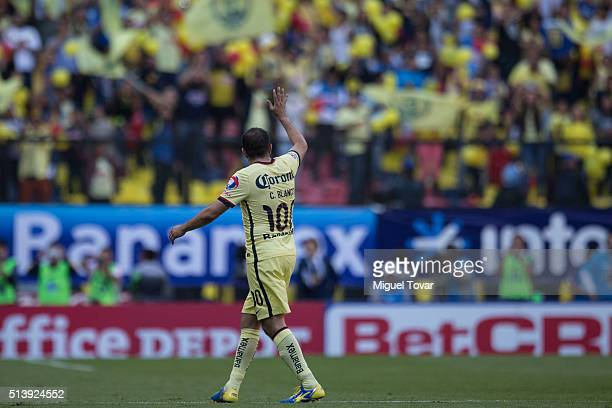 Cuauhtemoc Blanco of America leaves the field as he greets the fans during the 9th round match between America and Morelia as part of the Clausura...