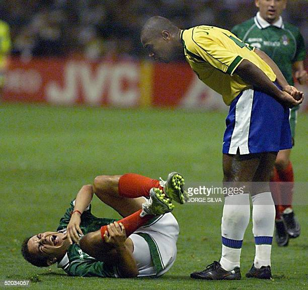 Cuauhtemoc Blanco of Mexico screams after Joao Carlos of Brazil fouled him 04 August 1999 during the final game of the Confederations Cup in Mexico...