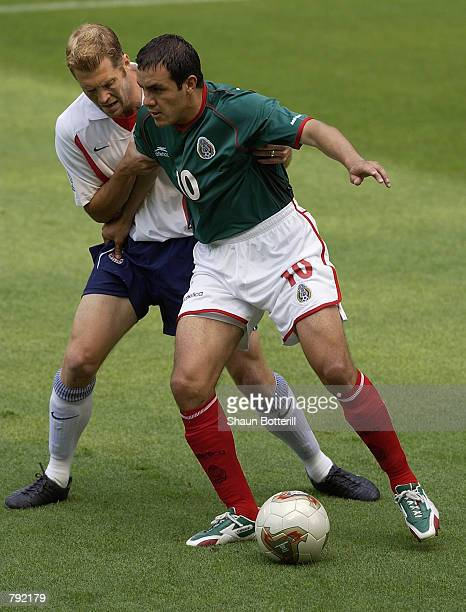 Cuauhtemoc Blanco of Mexico shields the ball from Gregg Berhalter of the USA during the FIFA World Cup Finals 2002 Second Round match played at the...