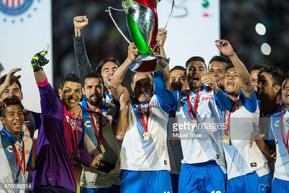 Cuauhtemoc Blanco of Puebla holds the trophy after winning the Championship match between Puebla and Chivas as part of Copa MX Clausura 2015 at...