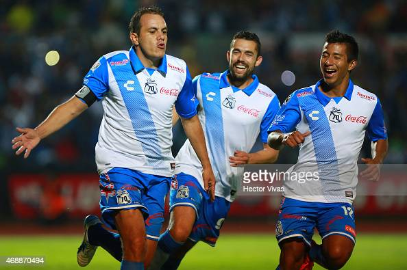 Cuauhtémoc Blanco of Puebla celebrates with teammates after scoring the third goal of his team during a semifinal match between Puebla and Monterrey...
