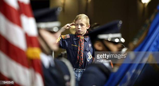 Cub Scout salutes the honor guard during the opening of the Eighth Anniversary memorial service of the Oklahoma City Murrah Federal building Bombing...