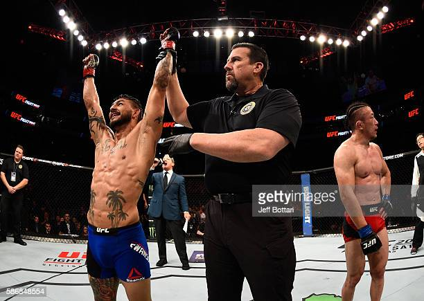 Cub Swanson celebrates his victory over Tatsuya Kawajiri of Japan in their featherweight bout during the UFC Fight Night event at Vivint Smart Home...