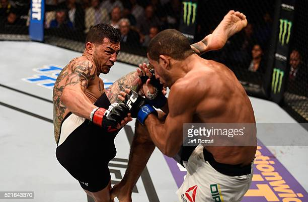 Cub Swanson kicks Hacran Dias in their featherweight bout during the UFC Fight Night event at Amalie Arena on April 16 2016 in Tampa Florida
