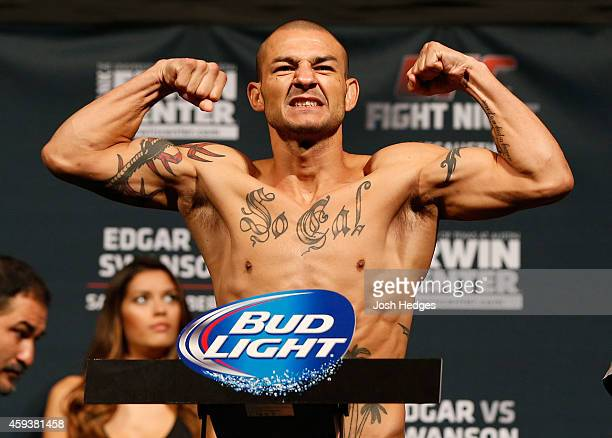 Cub Swanson poses on the scale after weighing in during the UFC weighin at The Frank Erwin Center on November 21 2014 in Austin Texas