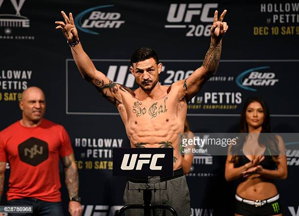 Cub Swanson poses on the scale during the UFC 206 weighin inside the Air Canada Centre on December 9 2016 in Toronto Ontario Canada