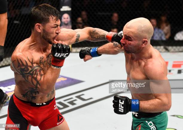 Cub Swanson punches Artem Lobov of Russia in their featherweight bout during the UFC Fight Night event at Bridgestone Arena on April 22 2017 in...