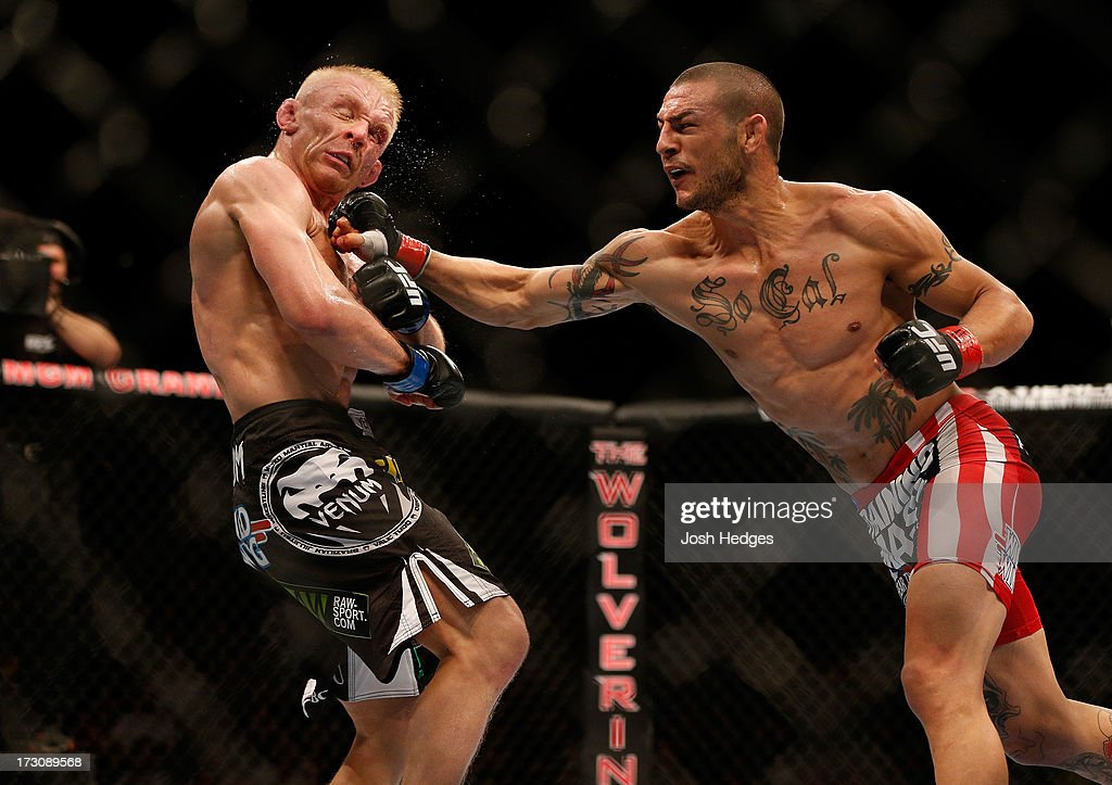 Cub Swanson punches Dennis Siver in their featherweight fight during the UFC 162 event inside the MGM Grand Garden Arena on July 6, 2013 in Las Vegas, Nevada.
