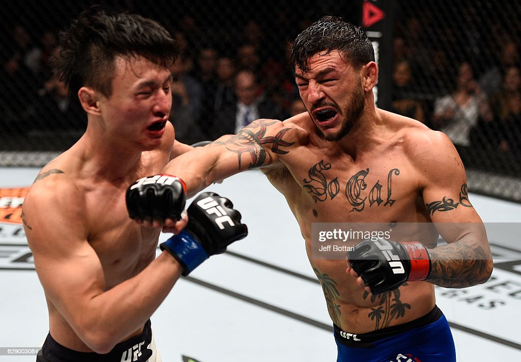 Cub Swanson punches Dooho Choi of South Korea in their featherweight bout during the UFC 206 event inside the Air Canada Centre on December 10, 2016 in Toronto, Ontario, Canada.