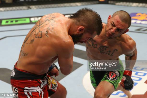 Cub Swanson punches Jeremy Stephens in their featherweight bout at the ATT Center on June 28 2014 in San Antonio Texas