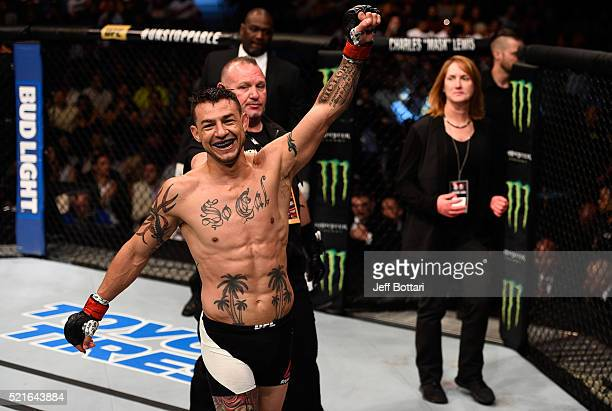 Cub Swanson raises his hand after facing Hacran Dias in their featherweight bout during the UFC Fight Night event at Amalie Arena on April 16 2016 in...