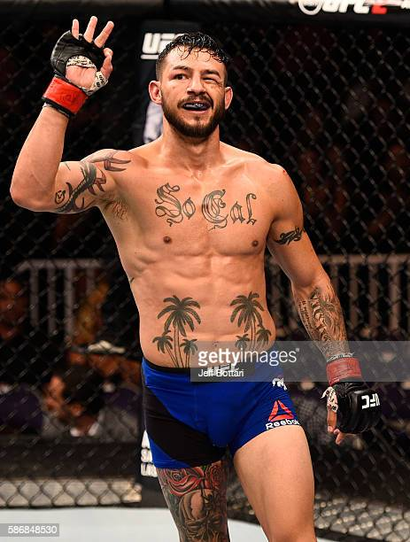 Cub Swanson raises his hand after facing Tatsuya Kawajiri of Japan in their featherweight bout during the UFC Fight Night event at Vivint Smart Home...
