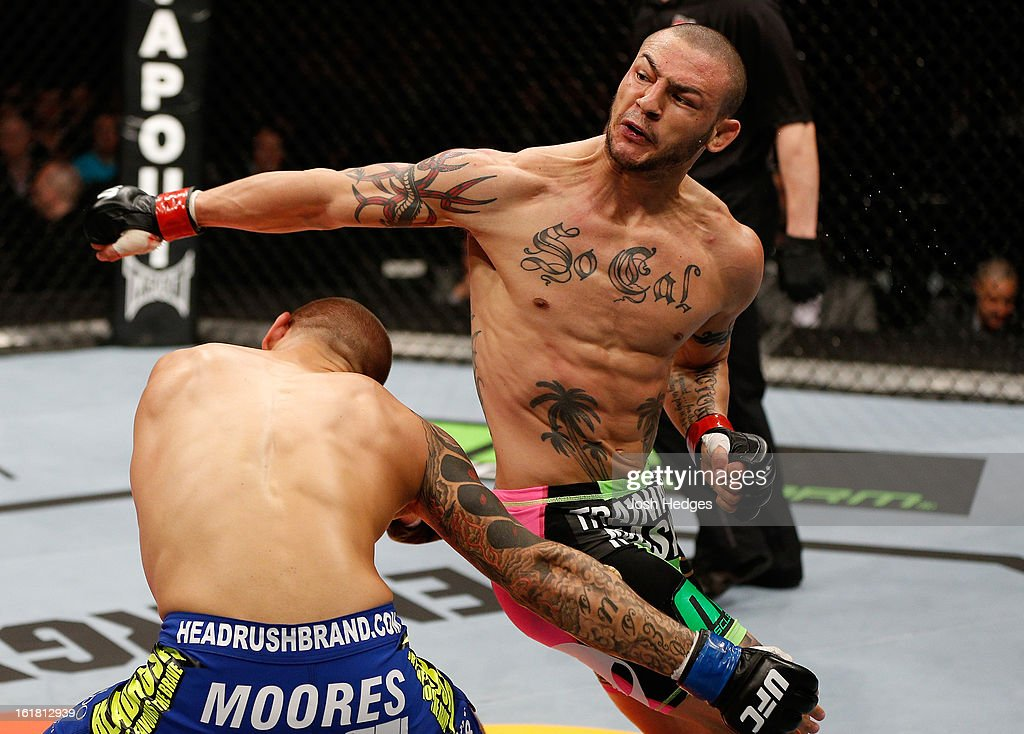 Cub Swanson throws a spinning back fist against Dustin Poirier in their featherweight fight during the UFC on Fuel TV event on February 16, 2013 at Wembley Arena in London, England.