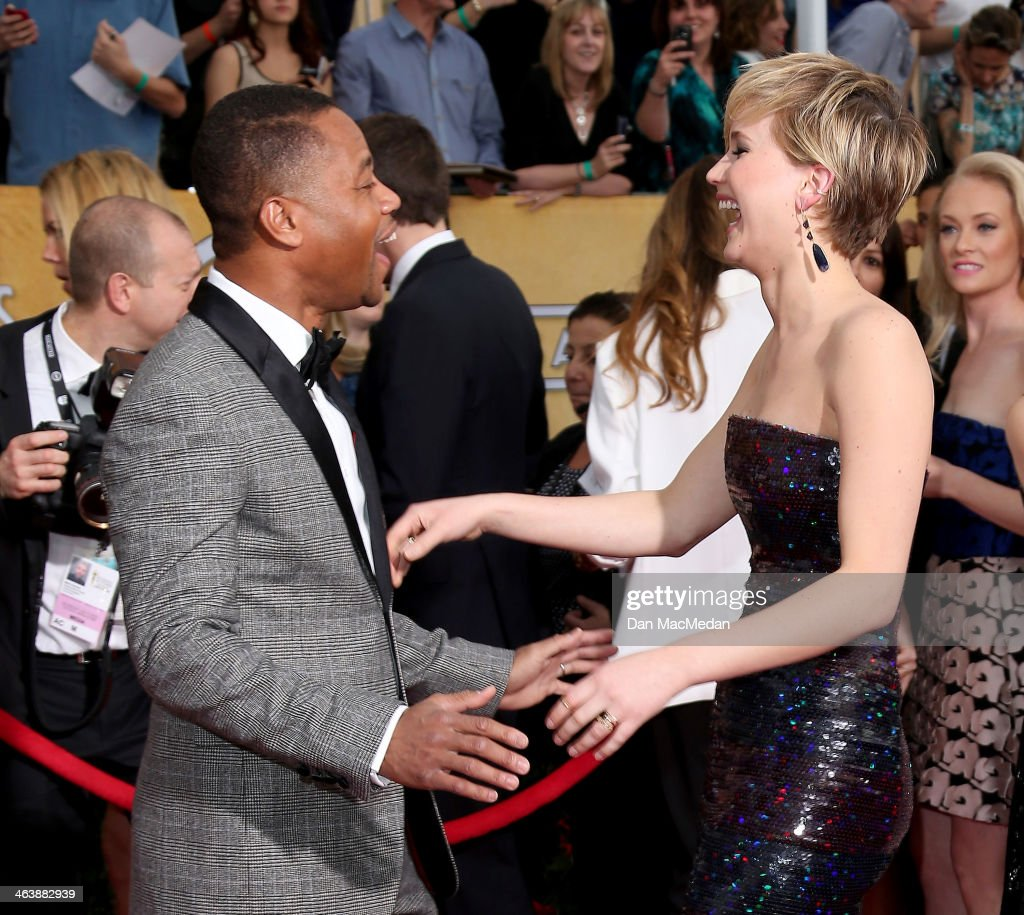 <a gi-track='captionPersonalityLinkClicked' href=/galleries/search?phrase=Cuba+Gooding+Jr.&family=editorial&specificpeople=208232 ng-click='$event.stopPropagation()'>Cuba Gooding Jr.</a> and <a gi-track='captionPersonalityLinkClicked' href=/galleries/search?phrase=Jennifer+Lawrence&family=editorial&specificpeople=1596040 ng-click='$event.stopPropagation()'>Jennifer Lawrence</a> (R) arrive at the 20th Annual Screen Actors Guild Awards at the Shrine Auditorium on January 18, 2014 in Los Angeles, California.