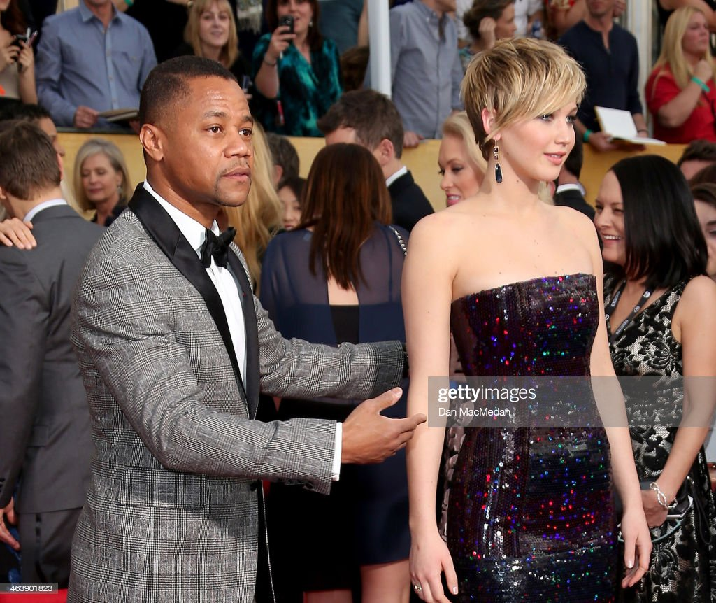 Cuba Gooding Jr. and Jennifer Lawrence (R) arrive at the 20th Annual Screen Actors Guild Awards at the Shrine Auditorium on January 18, 2014 in Los Angeles, California.