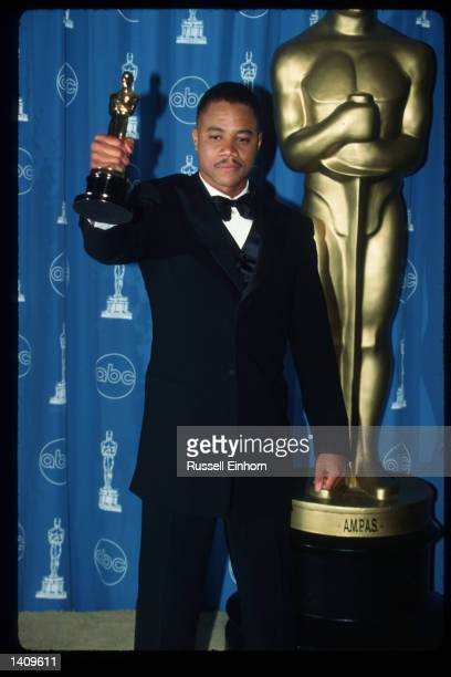 Cuba Gooding Jr holds his award for Best Performance By An Actor In A Supporting Role for 'Jerry Maguire' at the 69th Annual Academy Awards ceremony...