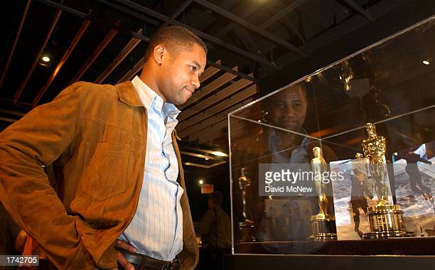 Cuba Gooding Jr looks at the Oscar statuette he won for Best Supporting Actor in 1996 for his role in 'Jerry McGuire' at the opening of the...