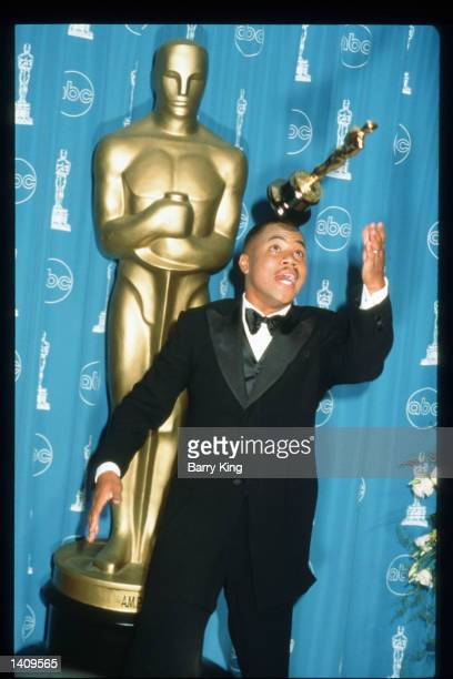 Cuba Gooding Jr poses with his award for Best Actor In A Supporting Role for 'Jerry Maguire' at the 69th Annual Academy Awards ceremony March 24 1997...