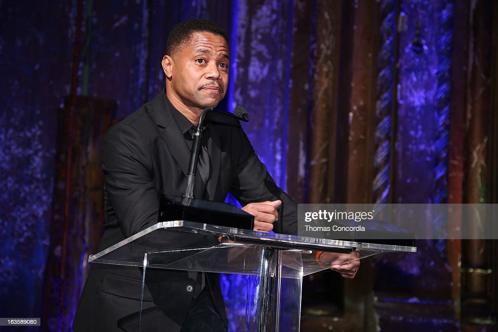 Cuba Gooding, Jr. presents an award to Lee Daniels at the Rock Art Love Ball on March 12, 2013 in New York City.