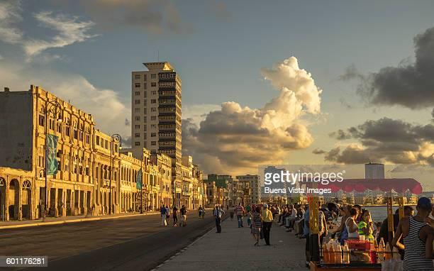 Cuba. Havana. People on El Malecon at sunset.
