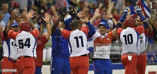 Cuba National baseball team celebrate with high fives for Alfredo Despaigne Yander Luis La O and Yulieski Gurriel after scoring over the Venezuela...