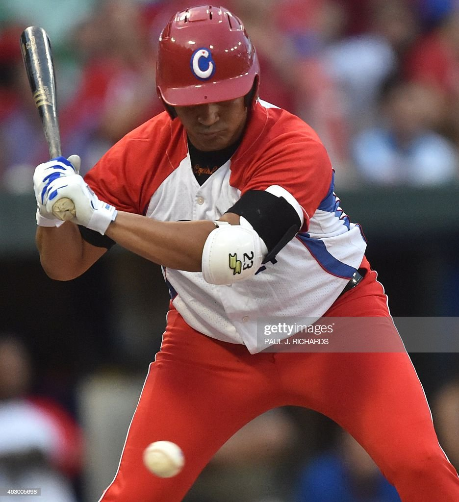 Cuba National baseball team infielder Frederich Cepeda watches a pitch sail by as he bats against the Mexico National baseball team in the final game of the Serie Del Caribe February 8,2015 in San Juan, Puerto Rico.