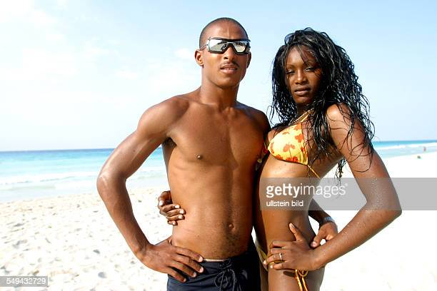 Portrait of a Cuban couples at the beach
