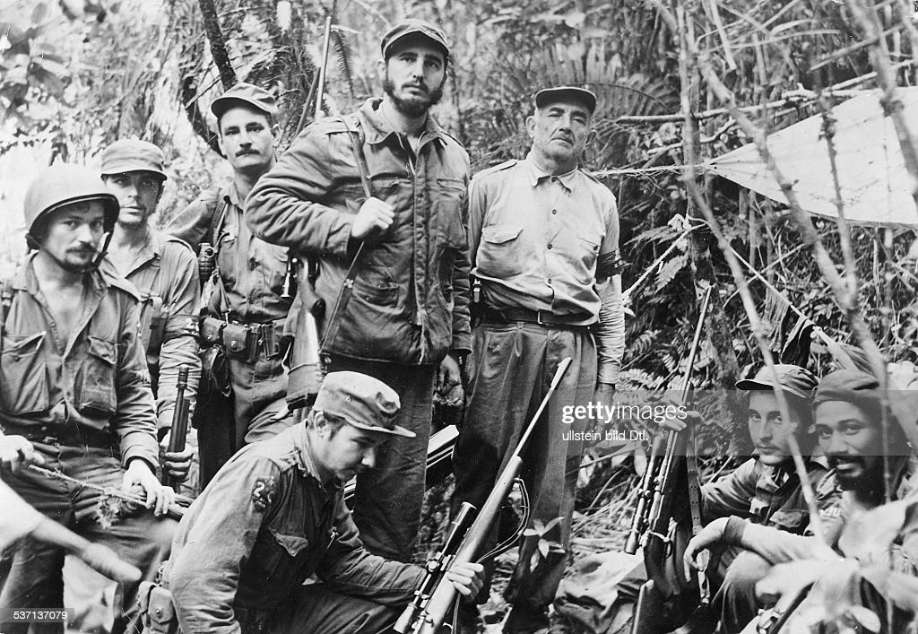 Cuba Revolution 1958/59 <a gi-track='captionPersonalityLinkClicked' href=/galleries/search?phrase=Fidel+Castro&family=editorial&specificpeople=67210 ng-click='$event.stopPropagation()'>Fidel Castro</a> (*-) Politician, Cuba Head of Government 1959-, Head of State 1976- <a gi-track='captionPersonalityLinkClicked' href=/galleries/search?phrase=Fidel+Castro&family=editorial&specificpeople=67210 ng-click='$event.stopPropagation()'>Fidel Castro</a> with his command staff in a secret jungle hideout| from right: Juan Almeide, George Sotus, Crescentio Perez, <a gi-track='captionPersonalityLinkClicked' href=/galleries/search?phrase=Fidel+Castro&family=editorial&specificpeople=67210 ng-click='$event.stopPropagation()'>Fidel Castro</a>, his brother Raoul (kneeling), Universo Sanchez, Ernesto <a gi-track='captionPersonalityLinkClicked' href=/galleries/search?phrase=Che+Guevara&family=editorial&specificpeople=67207 ng-click='$event.stopPropagation()'>Che Guevara</a> and Guillermo Garcia - 1958