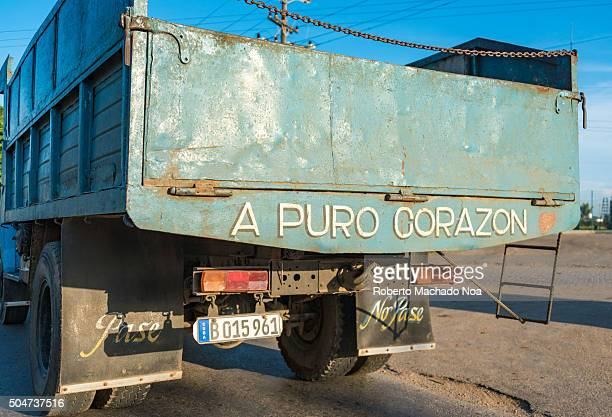 Cuba road scenes Rear view of truck with 'Pure Heart' slogan written on it at Central Road Pure heart slogan in the original Cuban culture means...
