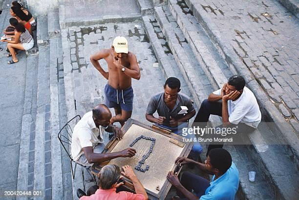 Cuba, Santiago de Cuba, men playing dominos on table on steps