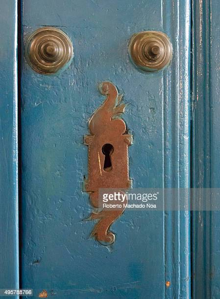 Cuba tourism Colonial style fittings on doors Antique brass keyhole covers or escutcheon on a door in the city of Sancti Spiritus Cuba