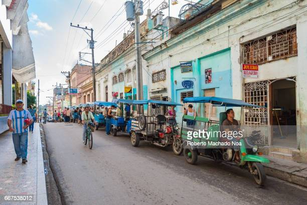 Cuba urban transportation line up of tricycles or 'motonetas' waiting for passengers in a downtown designated area Private self employment in the...